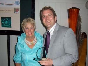 Pete Massey receives the George Hayward Award from Mo Hayward